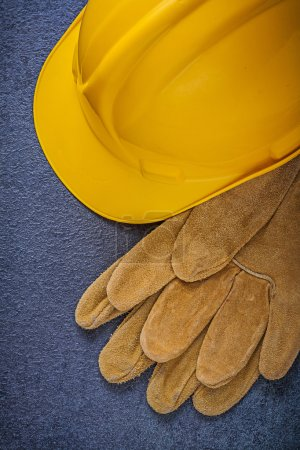 Safety hard hat and leather gloves