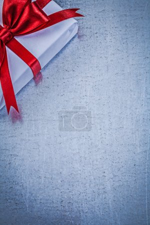 Packed gift with red bow