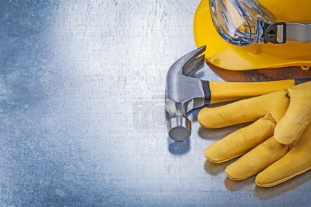 Hard hat, leather glove and hammer