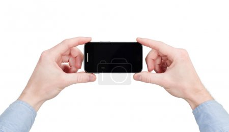 Hands holding touchscreen phone