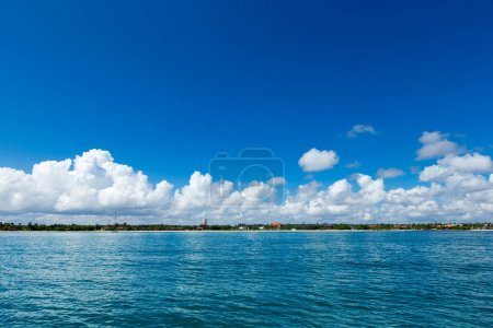 Photo for Clouds on blue sky over calm sea with sunlight reflection - Royalty Free Image