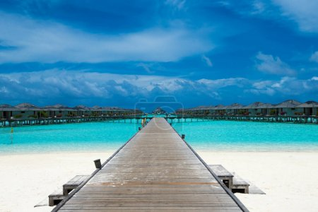 Photo for Beautiful beach with white sand.  ocean, blue sky with clouds.  Sunny day. Maldives tropical landscape - Royalty Free Image