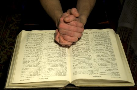 Mans hands and Bible