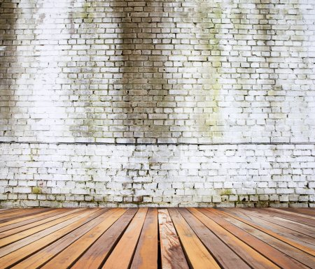 white brick wall and wood floor