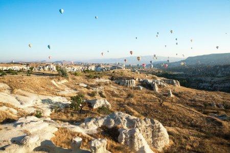 Hot-air balloons flying over the Cappadocia