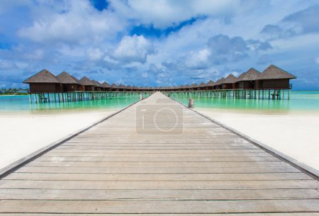 Beach with water bungalows and blue lagoon