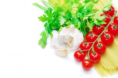ripe tomatoes with green leaves