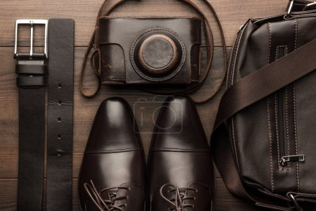 Brown shoes, belt, bag and film camera
