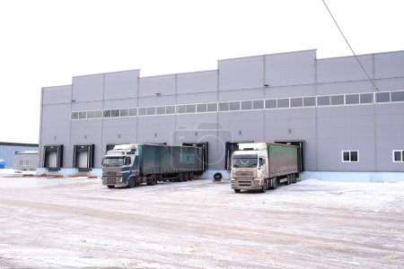 Photo for Tver region, Russia, February, 06,2015: trucks are loaded at the warehouse - Royalty Free Image