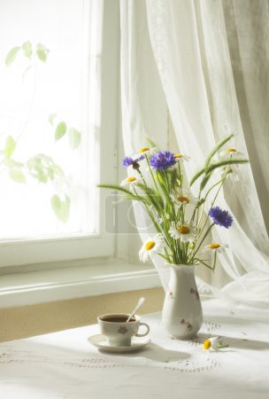 Wildflowers and cup of coffe