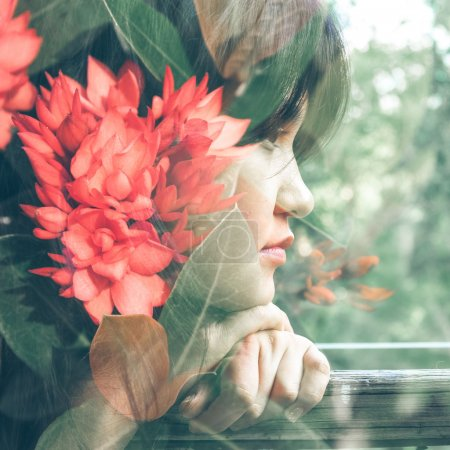 Photo for Double exposure photograph of attractive girl combined with photograph of flowers - Royalty Free Image