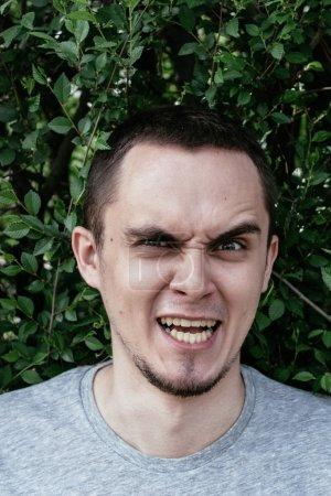 Angry young man snarling at the camera