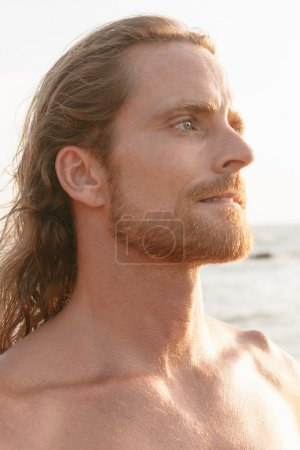 Bearded man with long hair