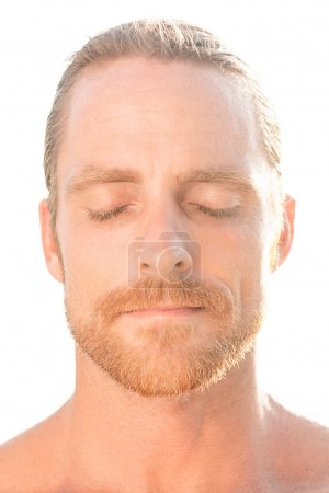 Attractive man with closed eyes