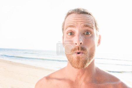 Surprised handsome man