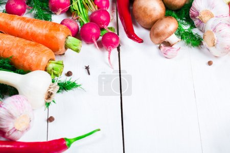 Photo for Beautiful background healthy organic eating. Studio photography the frame of different vegetables and mushrooms on the white boards with free space for you text - Royalty Free Image