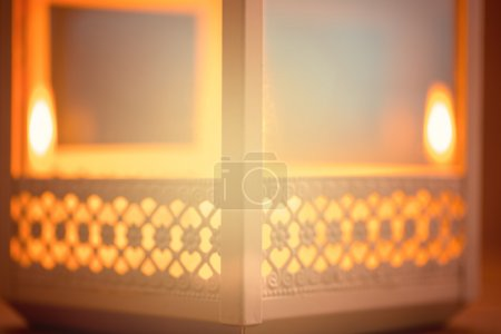 Photo for Beautiful blurred background with a glowing lantern.  The Muslim feast of the holy month of Ramadan Kareem. Free space for your text - Royalty Free Image