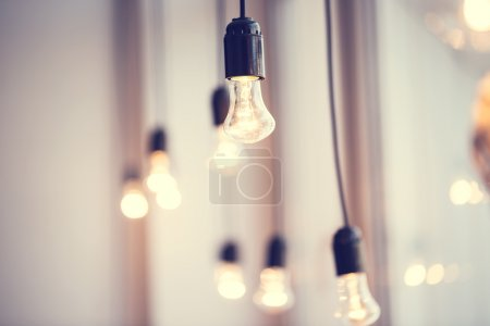 Light bulbs hanging at window