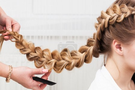 Photo for Weave braid girl in a hair salon - Royalty Free Image