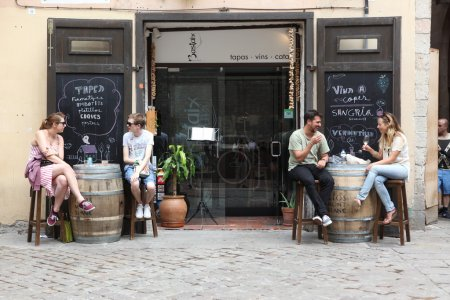 People in street cafe of Barcelona