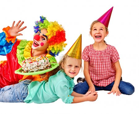Photo for Clown keeps cake on birthday with two children. Isolated - Royalty Free Image