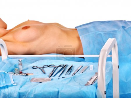 Preparation to breast surgery  on instruments background.