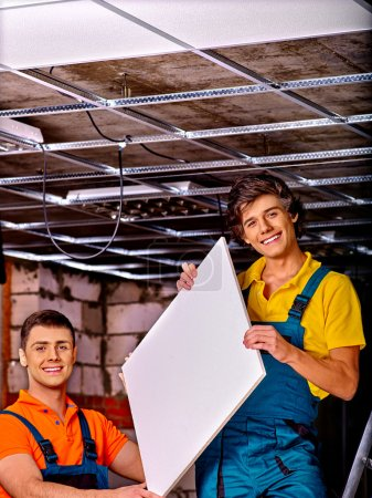 The two men set a false ceiling.
