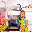 Постер, плакат: Children poorly cooking chicken at kitchen
