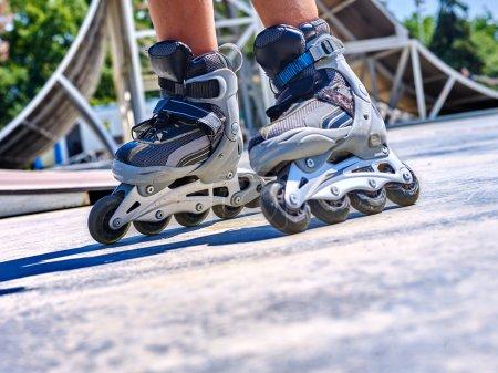 Girl riding on roller skates .