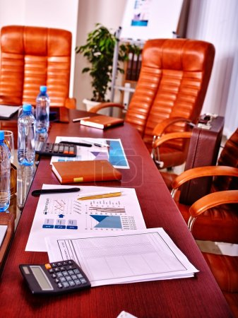 Photo for Business interior with four leather chairs in office. There are bottles water on the table. - Royalty Free Image