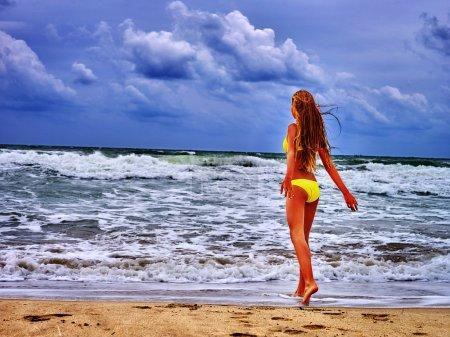 summer girl sea in yellow swimsuit
