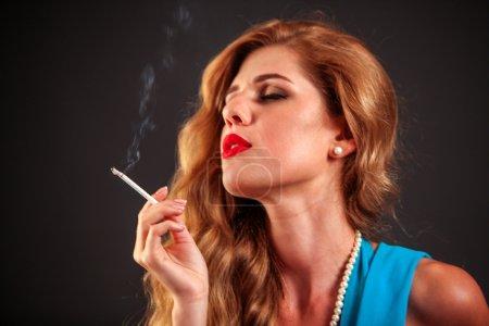Portrait of girl smoking cigarette.