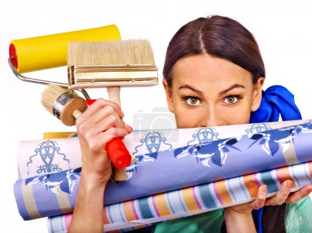 Builder woman with rolls of wallpapers. Isolated....