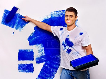 Man paint wall