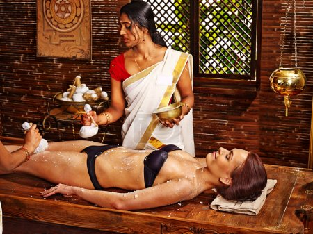 Woman having Ayurvedic feet  massage.