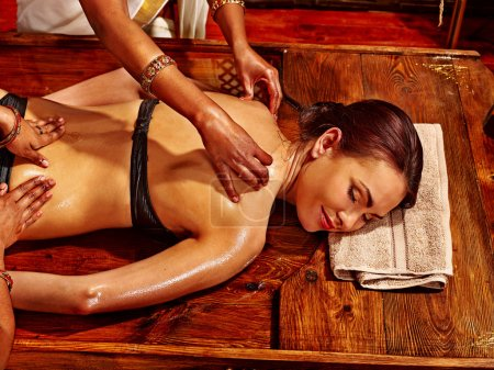 Woman having Ayurvedic treatment.