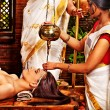 Young woman having oil Ayurveda spa treatment....