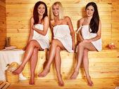 Women relaxing in sauna.