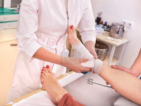 Doctor bandaging foot