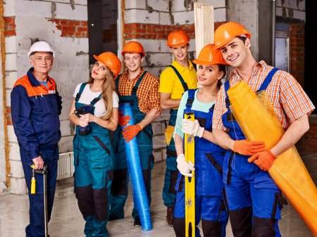 Group people in builder uniform.