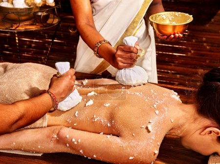 Woman having massage with   ice.