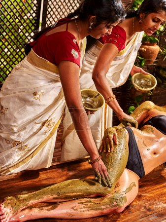 Woman having Ayurvedic body   massage.