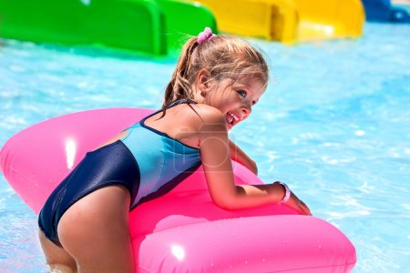 Photo for Child on blue water slide at aquapark. Summer holiday. - Royalty Free Image