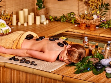 Woman getting stone therapy  .