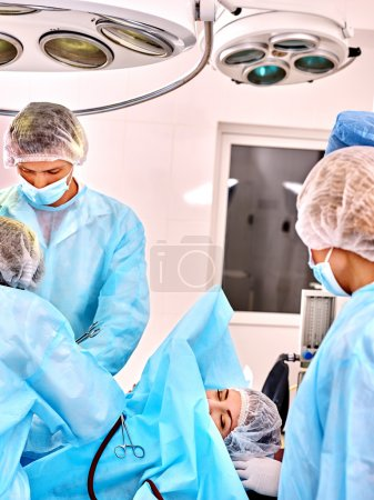 Surgeon in operating room.