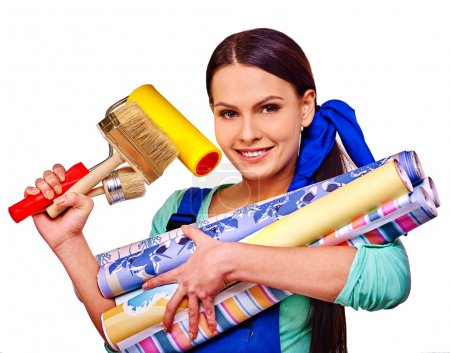 Builder smiling woman with roll wallpapers. Isolat...