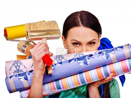 Photo for Builder woman  looks out for wallpaper roll. - Royalty Free Image