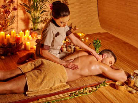 Man getting herbal ball massage
