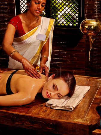 Photo for Young woman having oil Ayurveda spa Indian treatment. - Royalty Free Image