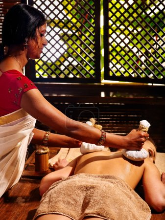 Woman having massage with pouches.